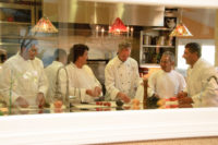 Chef Staff Seen in Action through Gatherings Viewing Window